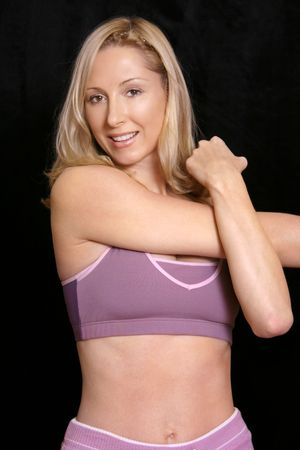exertion: Woman stretches in fitness gear