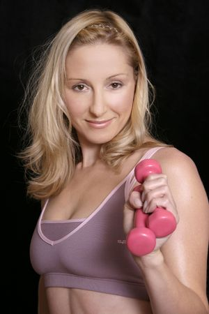 sculpt: Body Sculpt - a woman holding hand weights ready for exercise.