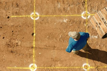 Builder stands by markings for the dig. Stock Photo - 259609
