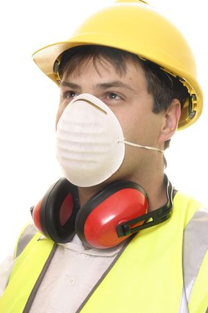 ear muffs: A worker wearing safety face mask, ear muffs and hard had