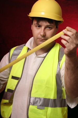 trusty: Builder with his trusty tape measure on a blackred background