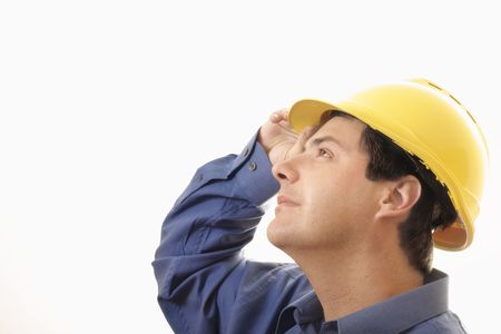 A man wearing hard hat  looking upwards with an optimistic expression