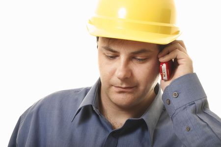 buiding: A man takes a phonecall on his cellphone