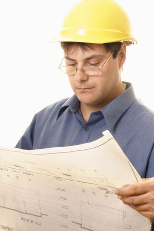buiding: A man reading architectural plans