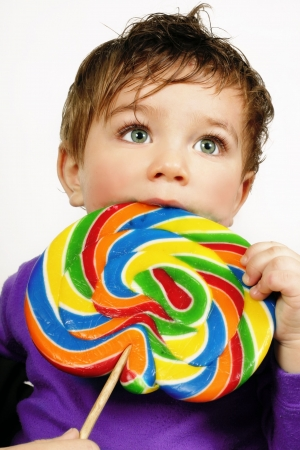 Boy with a very large candy