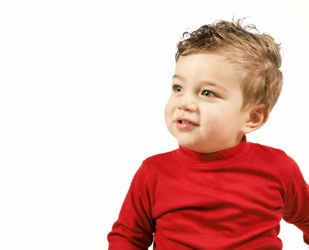 skivvy: A child looking sideways with space for your message. Stock Photo