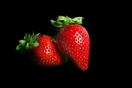 duet: Strawberry Duet - Two ripe strawberries on black Stock Photo