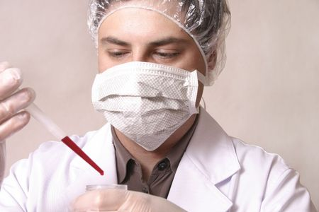 medico: Diagnosis.  Man testing a sample:  Could be a doctor or scientist.