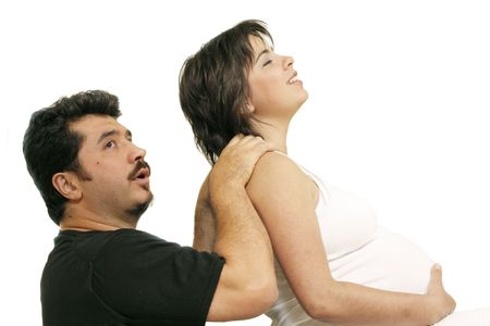 contractions: Husband massages a pregnant young woman to relieve pain or contractions. Stock Photo