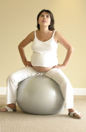 at ease: Pilates for Pregnancy - Light pilates exercises help ease discomfort for pregnant women