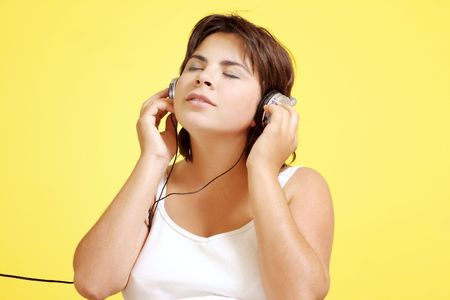 absorbed: Woman absorbed with the music Stock Photo