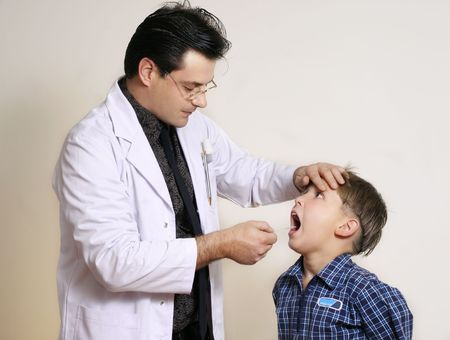 Doctor assessing a young patient Stock Photo - 263456