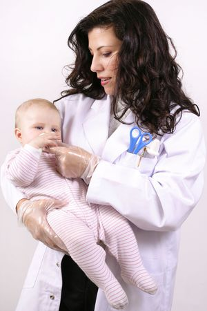 A doctor medicating a baby using a medicator. photo