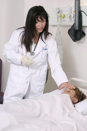 A nurse checks in on a patient photo