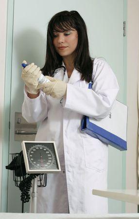 gloves nurse: Nurse in hospital with medical solution.