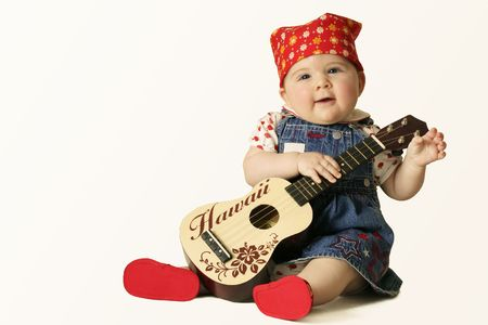 girl playing guitar: Groovy Baby -  Play me a tune