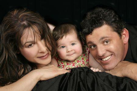 trio: Familly trio, mum, dad, baby girl Stock Photo