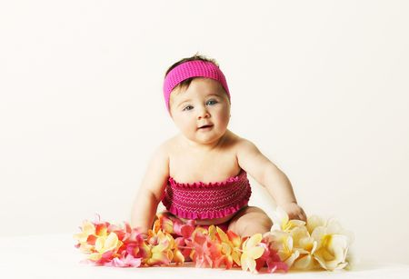 leis: Beach Babe - Baby girl in smocked pink top with floral leis.