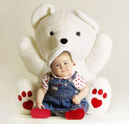 cuddly baby: Baby and teddy Stock Photo
