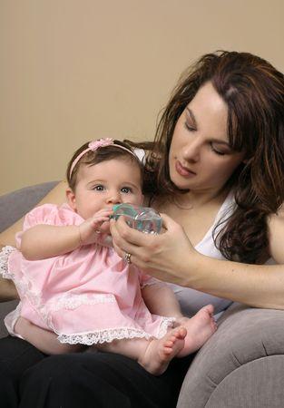 mothercare: Motherhood - Mother feeding her baby Stock Photo
