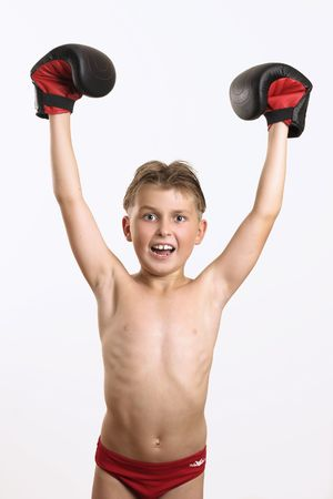 match box: Young boxer with arms raised in victory