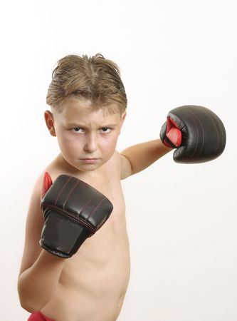 knockdown: Pow! Boy throws a punch  -  eg sports activities,  knockout deals, knockdown prices Stock Photo