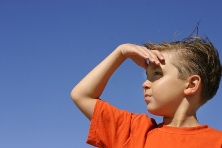 vigilant: Looking for a solution? answers? etc   Future outlook - Surveying an area - Hope or expectation...  A boy looks yonder way hand shielding the sunshine