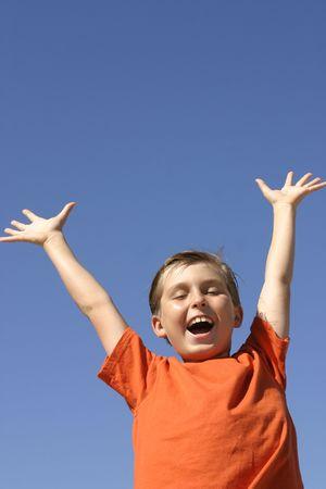 hooray: Child showing joy, praise, triumph, excitement - vertical Stock Photo
