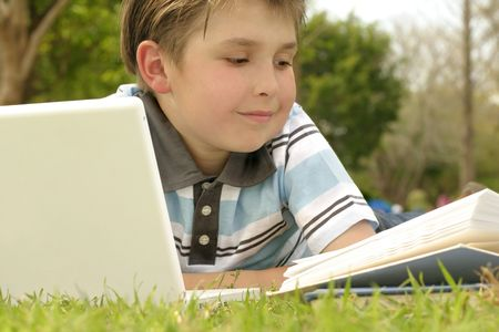 studious: A boy reading or studying. Stock Photo