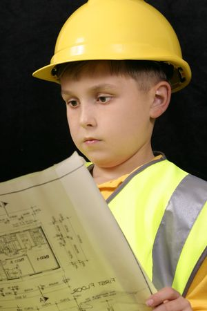 Young architect reviewing plans