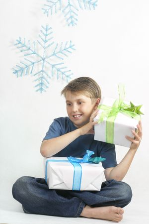 birthday religious: Child holding wrapped Christmas presents on a white background. Stock Photo