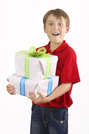Excited boy in jeans and red top carrying two gifts.