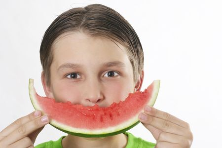 biten: Boy with a watermelon making a smiley face.