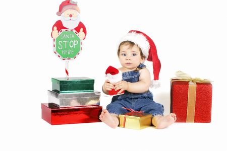 Santas Delivery - A young baby girl sitting amongst presents at Christmas time. Stock Photo - 272891