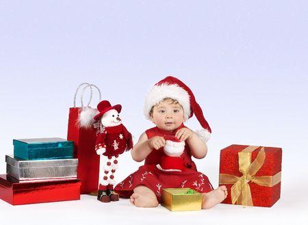 Winter Wonderland - Pretty baby girl on a soft falling snowflake background Stock Photo - 274440