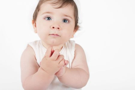 innocence: Hope and Innocence - A nine month old baby with hands clasped and looking up