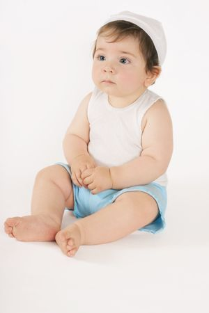 infancy: Sitting nine month old baby.
