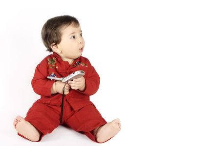gasp: Baby looking sideways with an adorable surprised expression.   Holding a flip phone.   Side space suitable for your message or product..