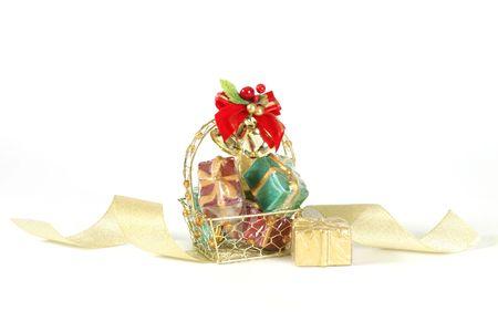 whitespace: Basket of decorative gifts on white background Stock Photo
