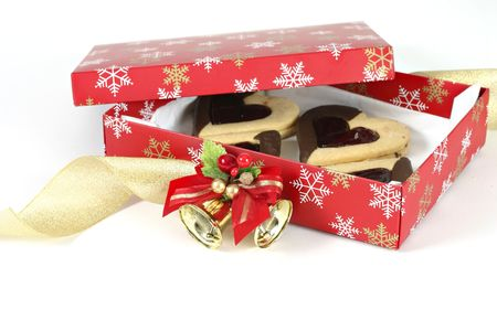 adorned: Hearts Desire A box filled with shortbread hearts.  Curling ribbon and bell decoration adorned box.