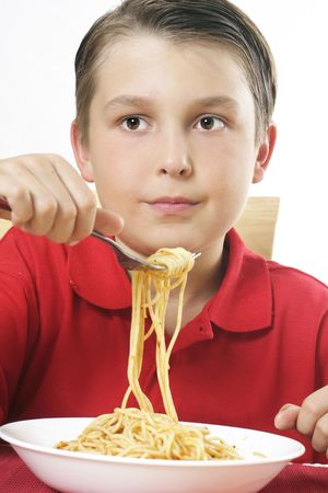 Child holding a large fork full of spaghetti noodles photo