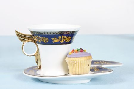 afternoon fancy cake: Teacup and cake on a table  - side view landscape version Stock Photo
