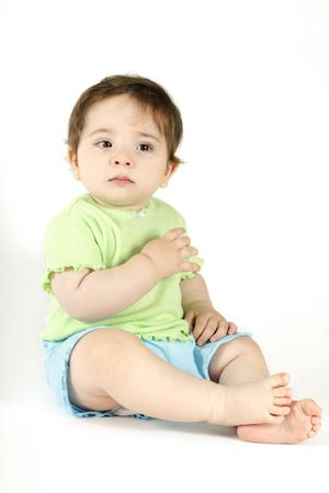 hurting: Baby Tears - Young baby wearing casual top and shorts sheds a tear.