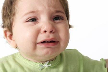 tantrum: Baby crying - hungry- teething- nappy change- tired- tantrum- sickness Stock Photo