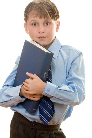 Schoolboy holding a bookeducation, learning, study, academic photo