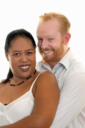 liaison: Happy diversity couple smiling and looking ahead