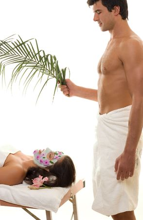 Relax and recharge.  A woman receives individual attention and pampering at a day spa for example. photo