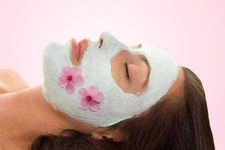 Beautify - A woman with botanical facial treatment Stock Photo