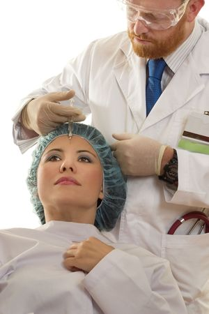 purified: Botox� is a purified protein produced by the Clostridium botulinum bacterium, which reduces the activity of the muscles that cause those frown lines between the brows (glabellar lines) to form over time. Stock Photo