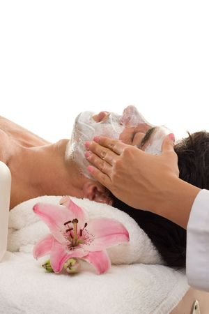 A man escapes the hustle and bustle of urban business life with a de-stressing trreatment at a day spa.   Male patronage at day spas has increased to over 20% of clientelle and this figure rises yearly.   Most popular male treatments are facial, massage,